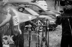 Brian Dallas of WD-40 Bike give a junior racer a quick wash, ensuring a somewhat cleaner drive home.